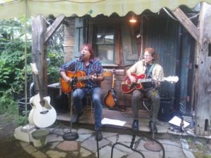 Mick Lawless and Tom Yates present a downsized Loose Salute performance to accommodate pandemic safety measures outdoors at Vincent's in Worcester.