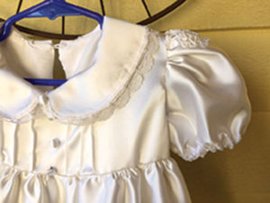 A christening dress sewn by Sandi Barrett