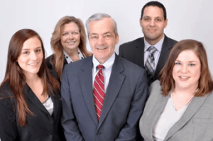 Dennis Sullivan & Associates team (shown in this photo) help you protect your family by creating a plan for your life savings.