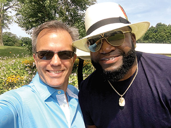 Tom Caron poses for a selfie with Red Sox star David Ortiz at a charity golf tournament.