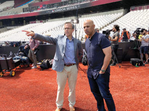 Tom Caron poses with Red Sox Manager Alex Cora before the MLB London Series in 2019.