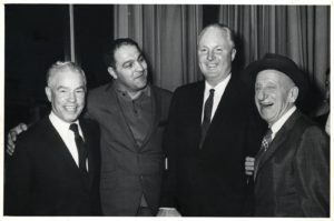 Rocky Marciano (second from left) stands with Former Boston Mayor John Collins and others. Photo via/Boston City Archives