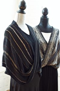 Handwoven Mobius shawls made of rayon boucle, lurex yarn, plus ribbon and supplemental yarns.  Credit: Gayle Zucker.