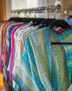 Handwoven Mobius shawls made of rayon boucle, lurex yarn, plus ribbon and supplemental yarns.
