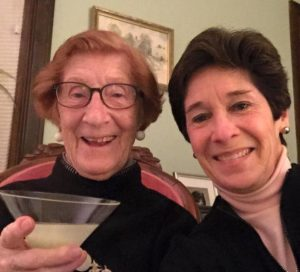 Jean Beddow-Arnth toasts her signature drink, Absolut Vodka Gimlet straight up, with Linda LeSage.