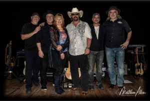 The Mychael David Project: (l to r) drummer Steve Kruglewicz, bassist Ed Lanzilotta, vocalist and percussionist Susan Jayne, vocalist and guitarist Mychael David, guitarist Jerry Prejean and keyboardist Glenn Stegner.