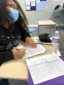 Windham Woods upper school student works on an essay.