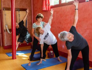 Barbara Lyon of Come to Yoga works with students in her studio prior to the COVID-19 pandemic.