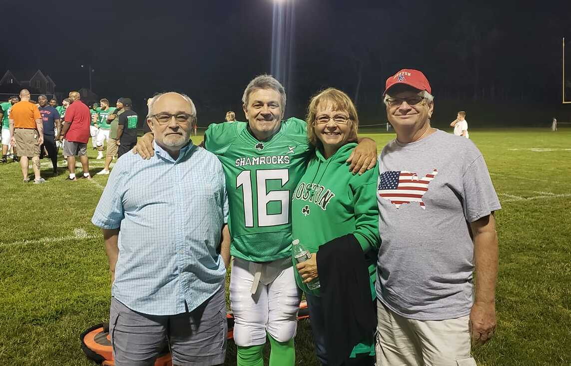 Patrick Caruso (second from left) with (l to r) his brother Dan Caruso, sister Beth Ferns, and brother-in-law Larry Ferns at Kelleher Field in Marlborough