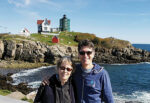 Phil Knutel stands with his birth mother Maggie Byrnes at the Nubble Lighthouse in York, Maine.