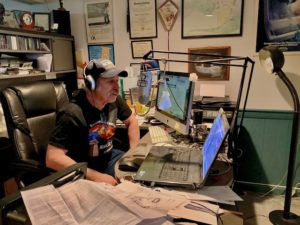 """Mark Skin Radio DJ Mark Schultz strives to keep audience members on their toes, serving up unusual news, throwbacks and interaction during his weekly program, """"On the Record."""""""