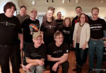 "Chris Johnson (front right) celebrated the first live event at the Zullo Art Gallery in Medfield with a group of DJs and the band ""The Cast Irons"" after the show."