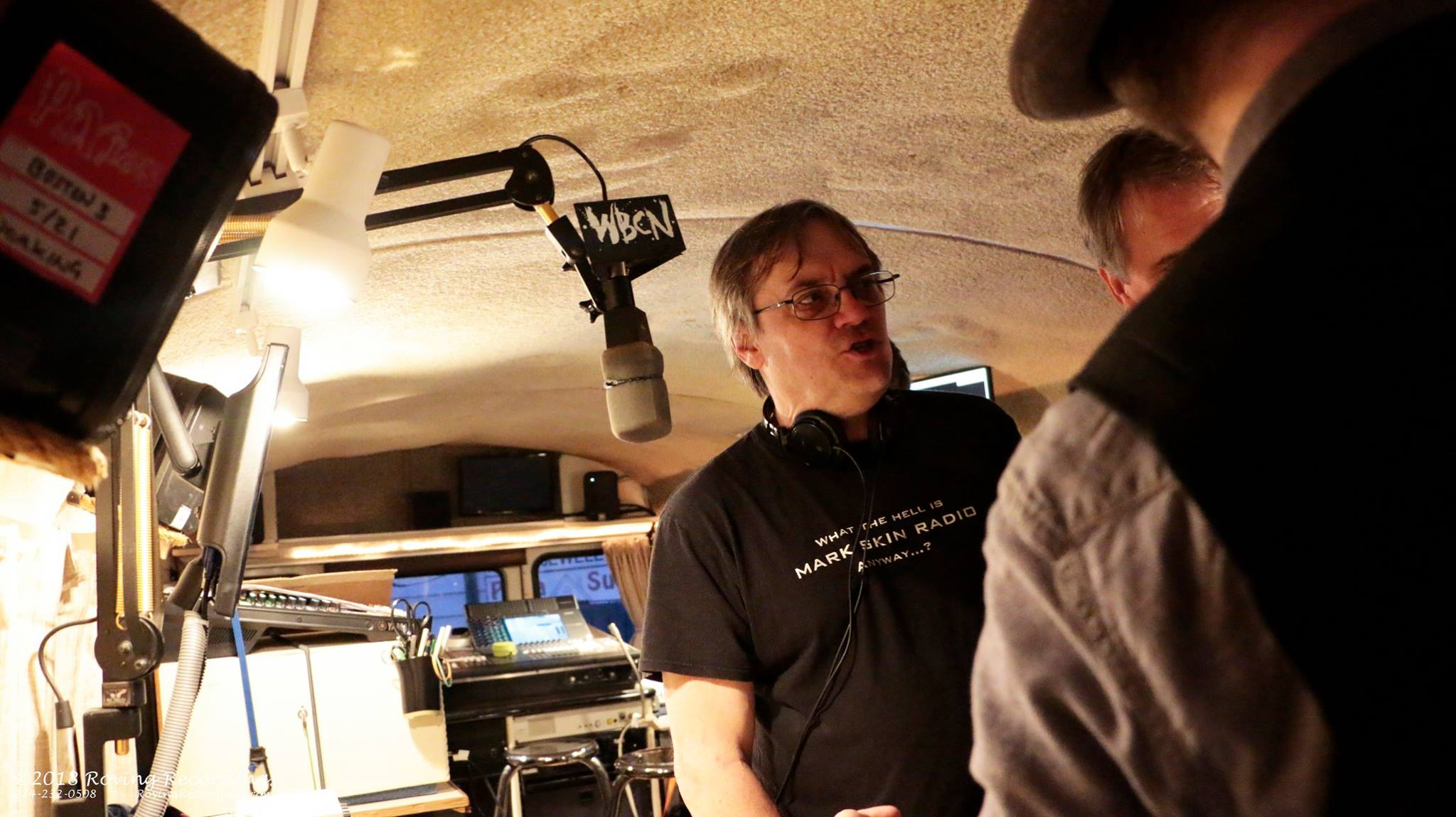 Chris Johnson conducted an interview in Sam Kopper's mobile studio in the early days.
