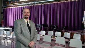 Dedham high school drama and music teacher Steven Bergman brings his professional theater experience to his students.