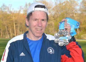 Dan Milton displays his World Marathon Majors medal.