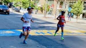 Connie Cao and son Enchee Xu cross the finish line of the 2020 Boston Marathon, which was a virtual race due to the pandemic.