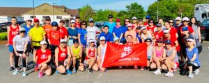 Connie Cao and son Enchee Xu stand (6th and 7th from left) with the BEN Running Club.