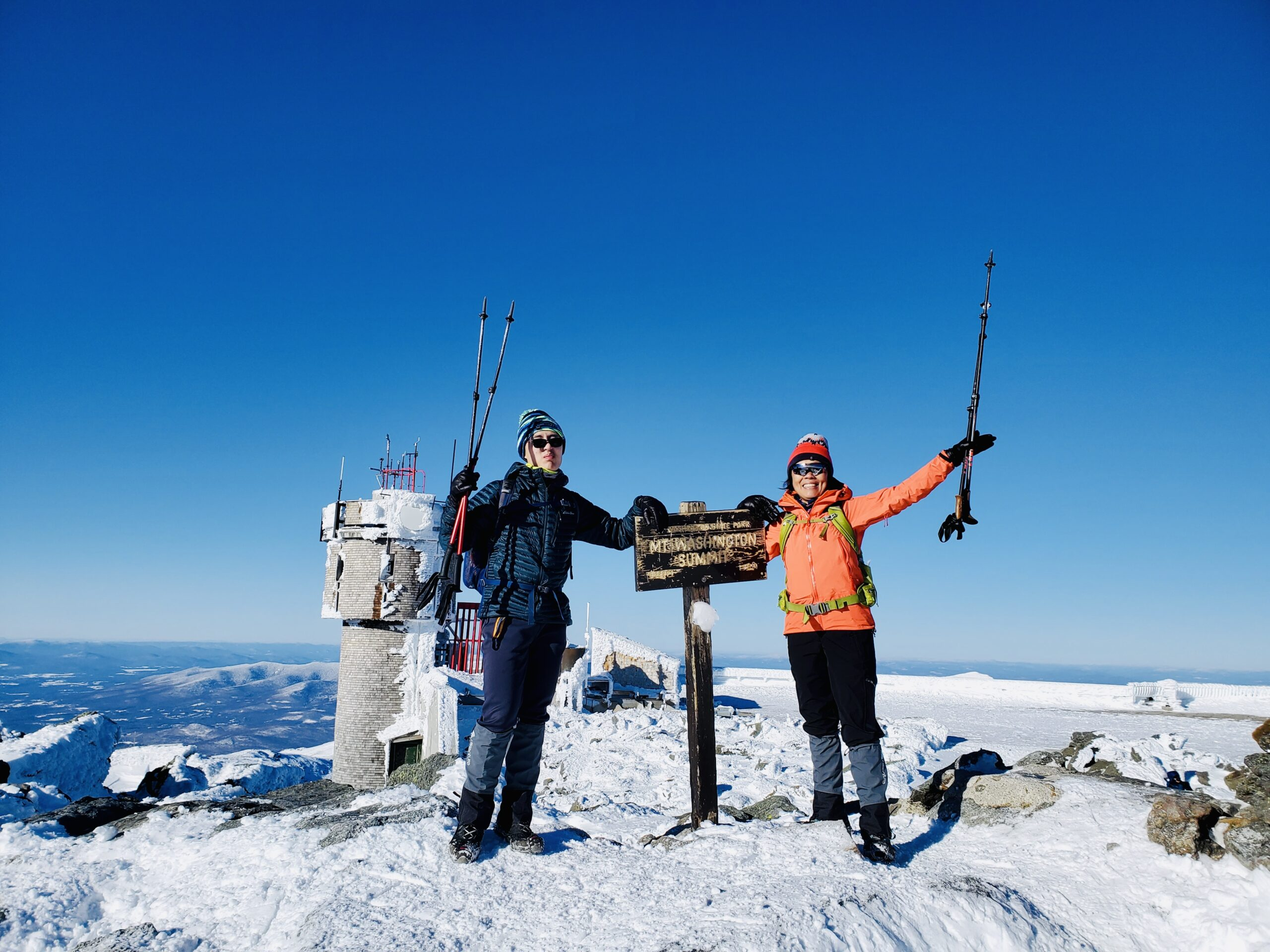 Connie Cao and son Enchee Xu pose at a Mount Washington summit on January 21, 2021.
