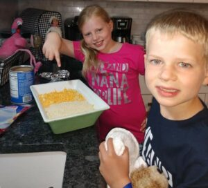 """Kailyn and Ryan Croeber make homemade macaroni and cheese on their first day of """"Nana Camp."""""""