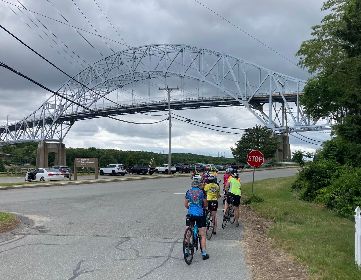 Riders approach the Sagamore Bridge, which they walk across with their bikes to enter Cape Cod.