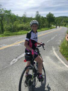 Kathleen MacNeil poses June 10, the first day of her trek, in Tyringham.