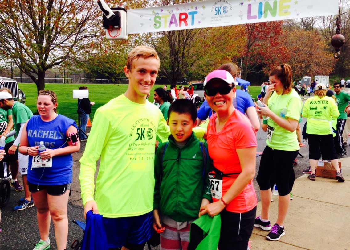 Connie Cao (right) poses with her son Enchee Xu (center) at the 2013 New England Center for Children 5K for Autism.