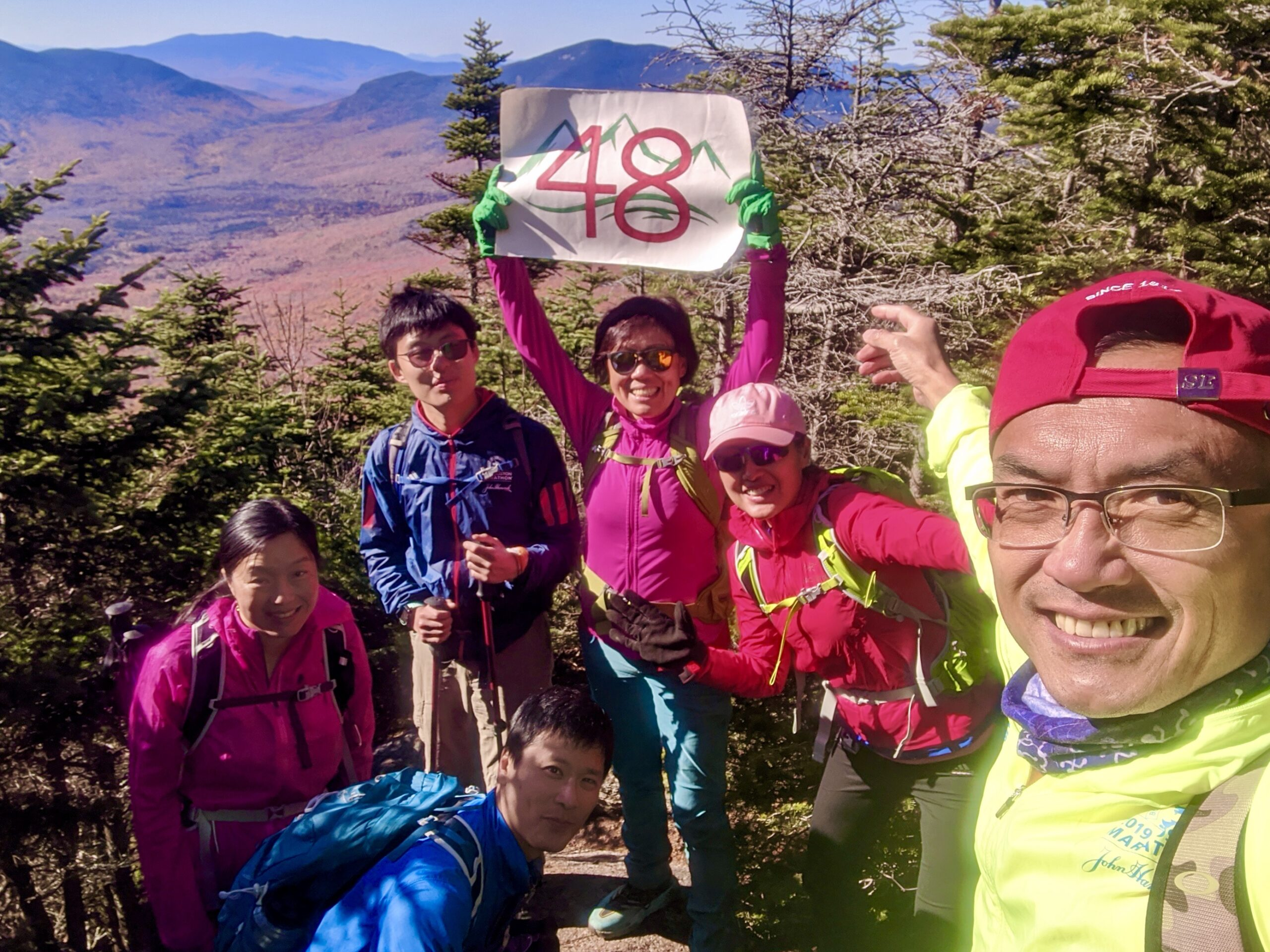 Connie Cao, her son Enchee, and a group of hikers completed the 48th of the Appalacian Mountain Club's 4000 Footers at Mt. Tripyramid, NH.
