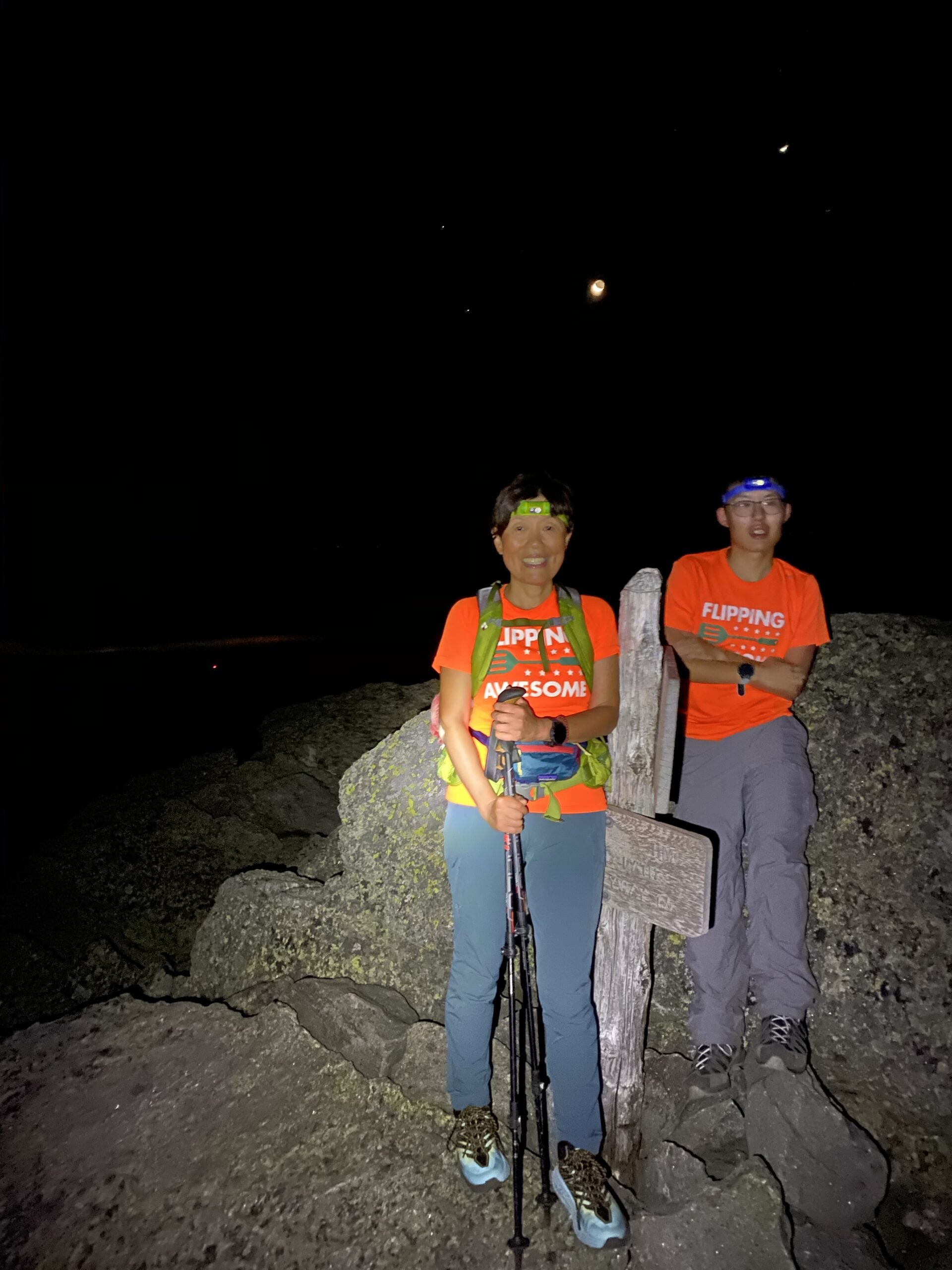 Connie Cao and son Enchee Xu posing at a summit of Mt. Madison in NH. The hike started at 12:30 a.m.