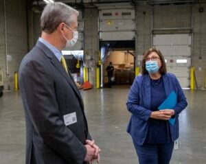 Gov. Charlie Baker meets with Catherine D'Amato at Greater Boston Food Bank.