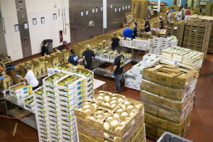 Volunteers sort and pack at Greater Boston Food Bank's central kitchen