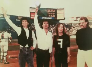 Singing the national anthem at Fenway Park prior to a Boston Red Sox game in the mid-1990s are The Fools' bandmates (l to r) Joe Holaday, Mike Girard, Rich Bartlett and Jim Taft. Photo/submitted