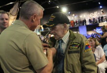 Alfred Consigli receives his French Legion of Honor medal.