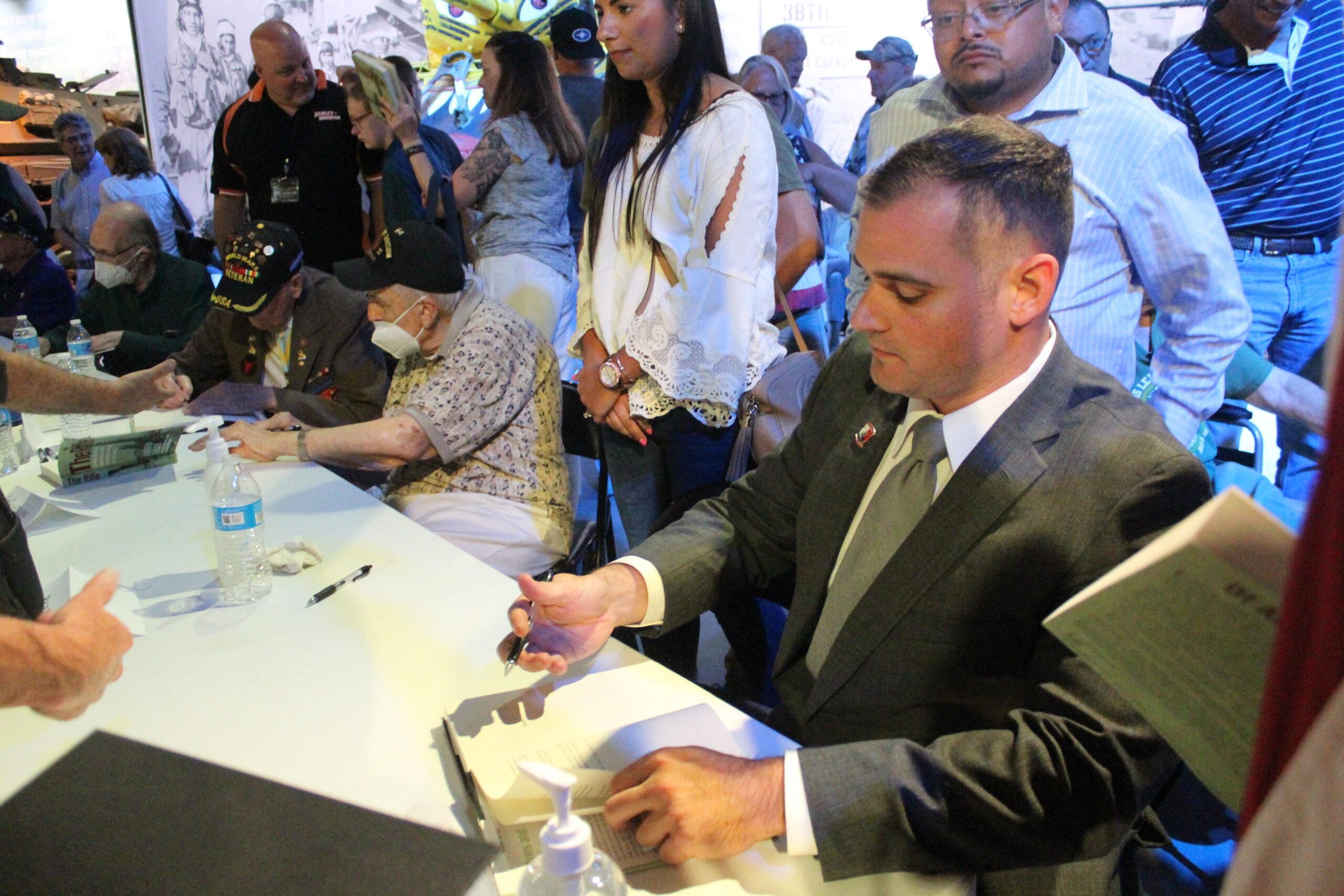 Andrew Biggio signs books.
