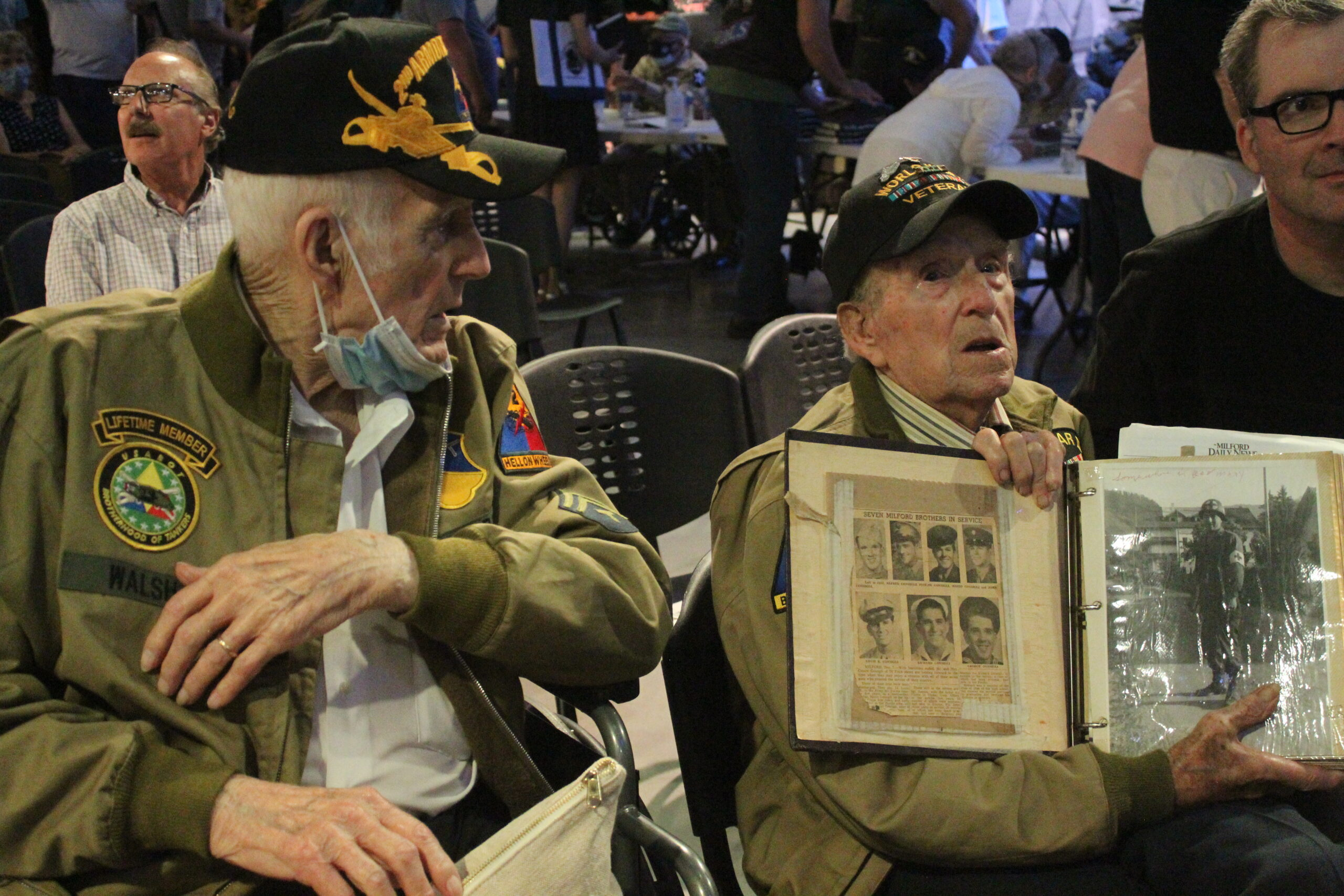 Alfred Consigli shares his photos with fellow veteran Philip Walsh.
