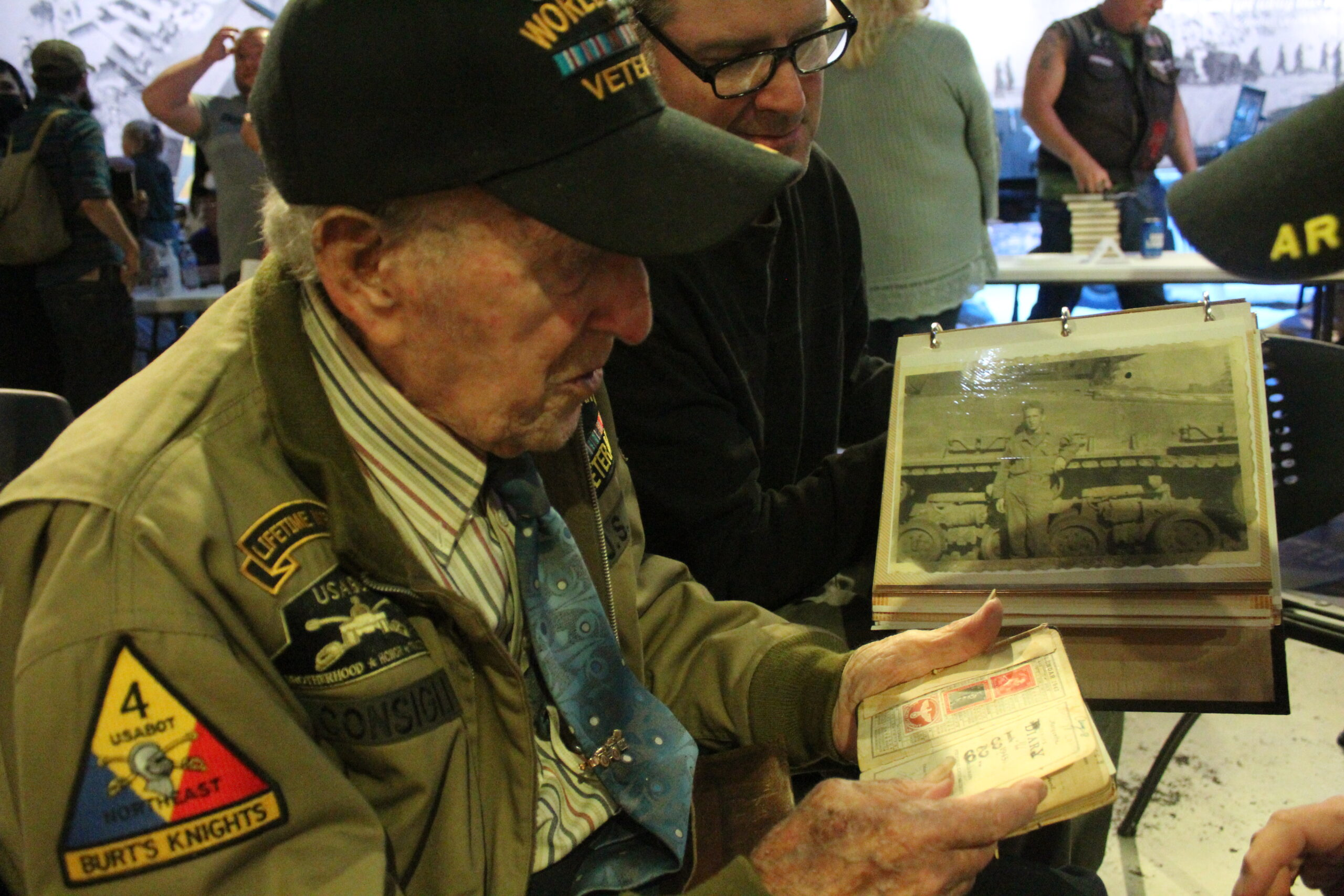 Alfred Consigli shows the journal he kept during WWII.