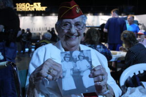 Mildred Cox shows a photo of her and her brother.