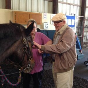 At an equine therapy program at Windrush Farm, people with dementia are introduced to a horse and develop a bond.