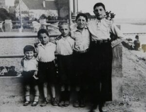 Israel Arbeiter, center, with his brothers in Poland before World War II. Photo/Submitted