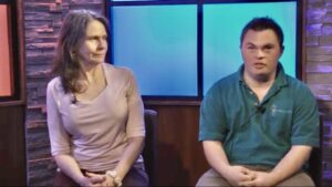 Marsha Manusco Caption 3: Marsha Mancuso and her son Mark discuss the next yoga class which airs monthly on local cable.
