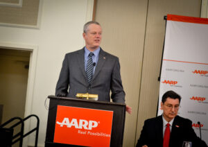 Governor Charlie Baker presents the blueprint recommendations of his Council to Address Aging in Massachusetts to AARP Massachuestts Director Mike Festa (right) on April 11, 2018, and announces joining the AARP Network of Age-Friendly States and Communities. Photo/Lucyus Fevrier/CC BY-NC-SA 4.0