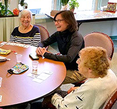 Mass. Secretary of Elder Affairs Alice Bonner (right) speaks with residents during her visit to Dartmouth's Council on Aging to kick-off Older American's Month in May.