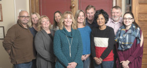 Joanne Peterson, with several of the Learn to Cope team members at their Taunton office.