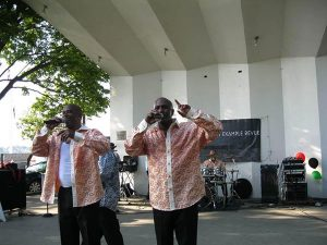 Lance (left) and Robert Williams perform on stage at the Salem, Mass. Willows Park