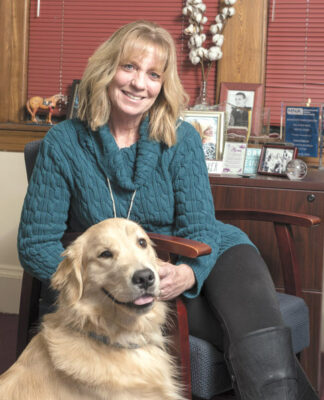 Joanne Peterson, the founder and executive director of Learn to Cope, with team member Kim Leman's dog, Finn.