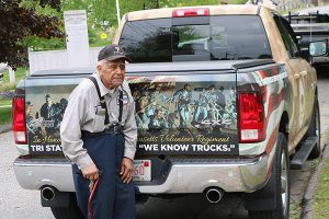 Pete DePina stands next to the truck that was a gift from his employer, Tri State Truck Center.