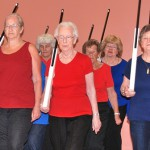 Peabody COA Senior Ladies Drill Team members practice with rifles made at the Peabody COA Woodworking Shop.
