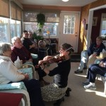 A violinist serenades café guests in Marlborough.