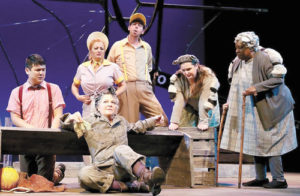 """Margaret Ann Brady as Templeton (front) with Wheelock Family Theatre's """"Charlotte's Web"""" cast"""
