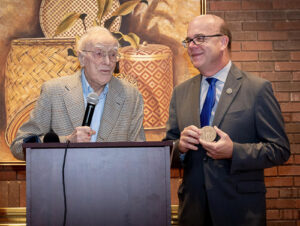 U.S. Rep. James McGovern presents the Congressional Gold Medal to Edward Daly.