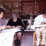 Women craft lace tablecloths by hand